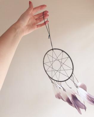 hand holding dreamcatcher